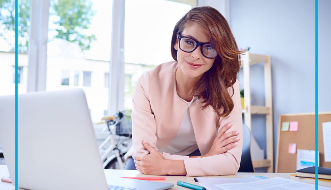 Portrait of businesswoman looking with confidence at camera